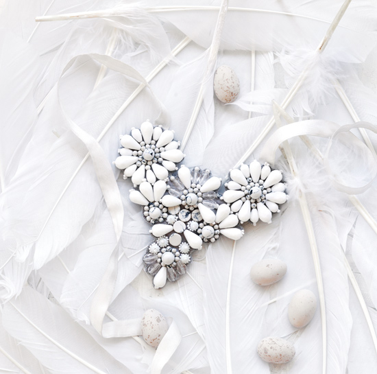 white-jewerly-feathers-cover