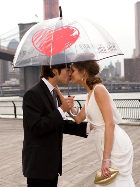 happy-couple-with-umbrella