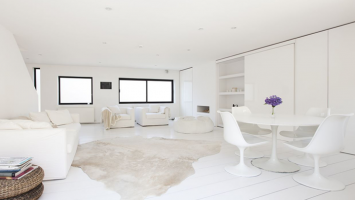white-living-room-with-purple-flowers